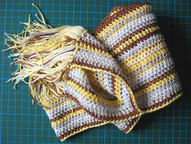 yellow, brown and white crocheted scarf